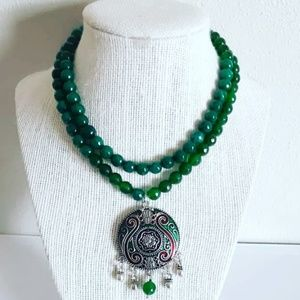 Green necklace with antique pendant!